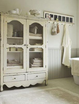 re-purposed armoire for bathroom.  you could use the tv hutch you got for dishes in the new room, or redo it with the cut outs in your downstairs bathroom (if there is room)