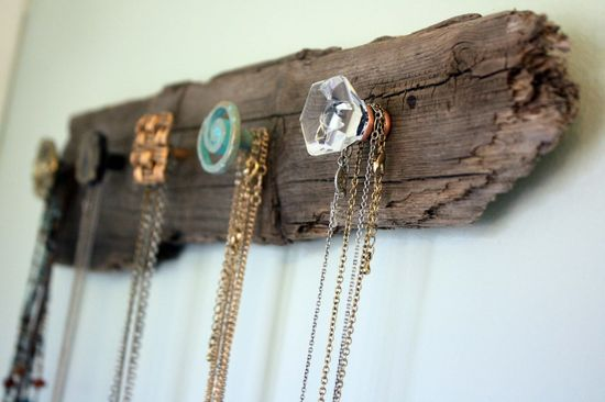 Driftwood necklace holder. I think something along these lines would be great in a cottage mudroom, for hanging odds and | http://bannerandgarland.blogspot.com