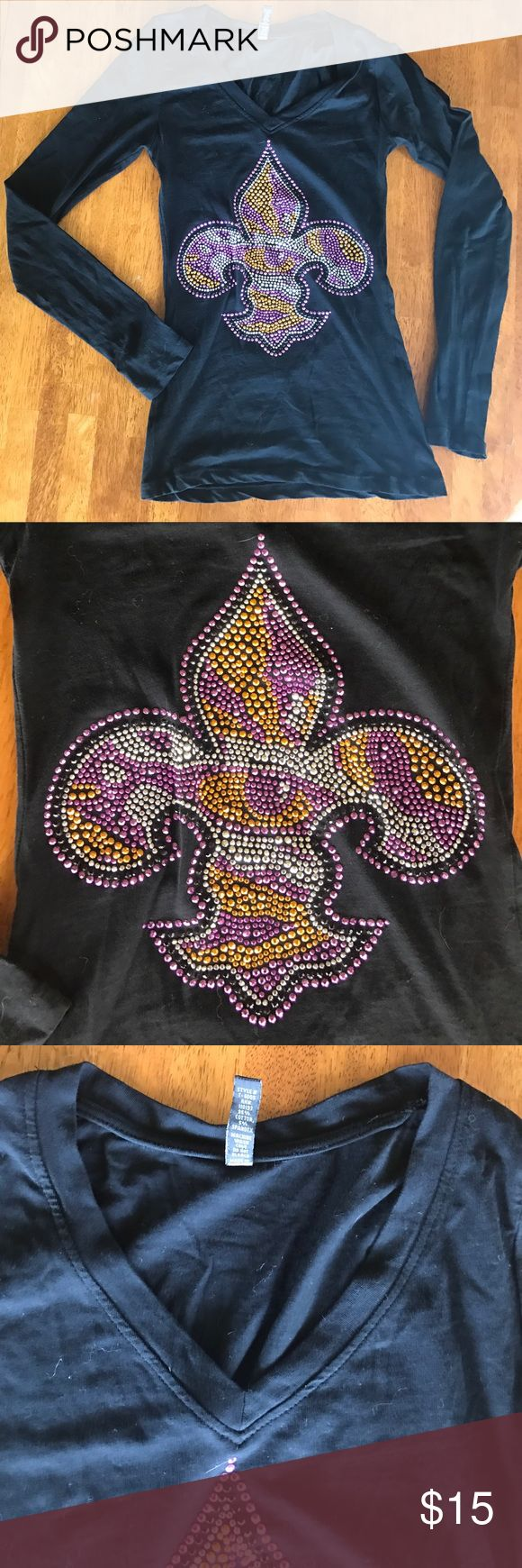 LSU Fleur de lis shirt with eye of the tiger. Black v-neck long sleeve shirt. Extremely cool and unique! Fleur de lis with eye of the tiger in the middle. Geaux tigers! LSU Tops Tees - Long Sleeve