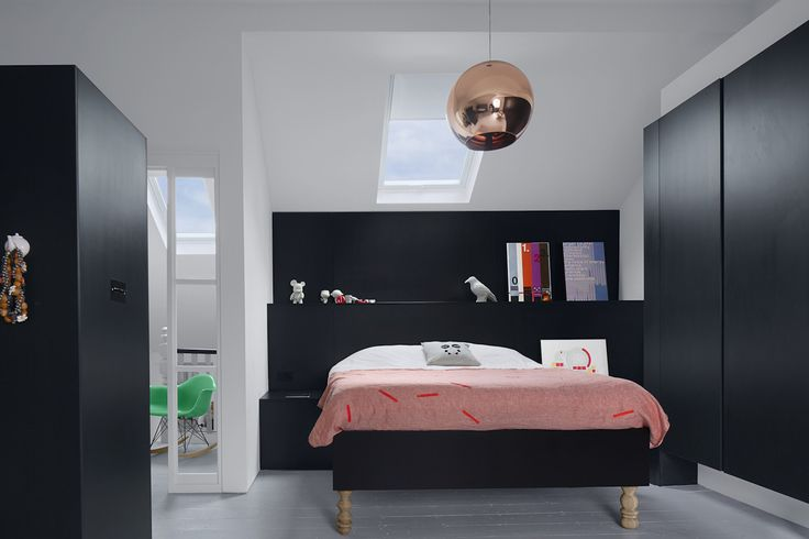 Kelross House:  Black Valchromat joinery creates bold definition in this large open-plan master suite.