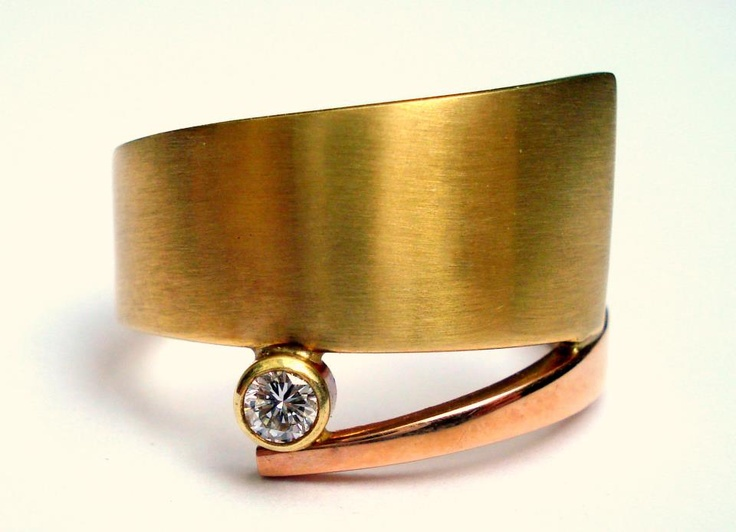 Rose and yellow gold ring with a diamond.