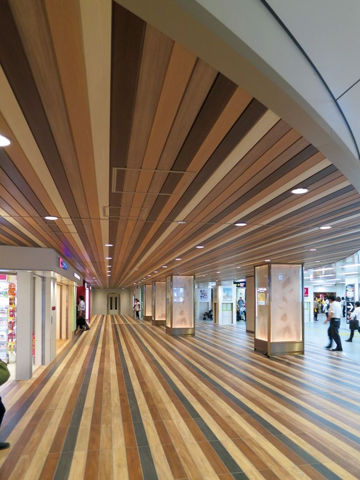 A Playful Yet Elegant Ceiling In This Shopping Center Uses Spandrels In Vent Walnut Prime Teak
