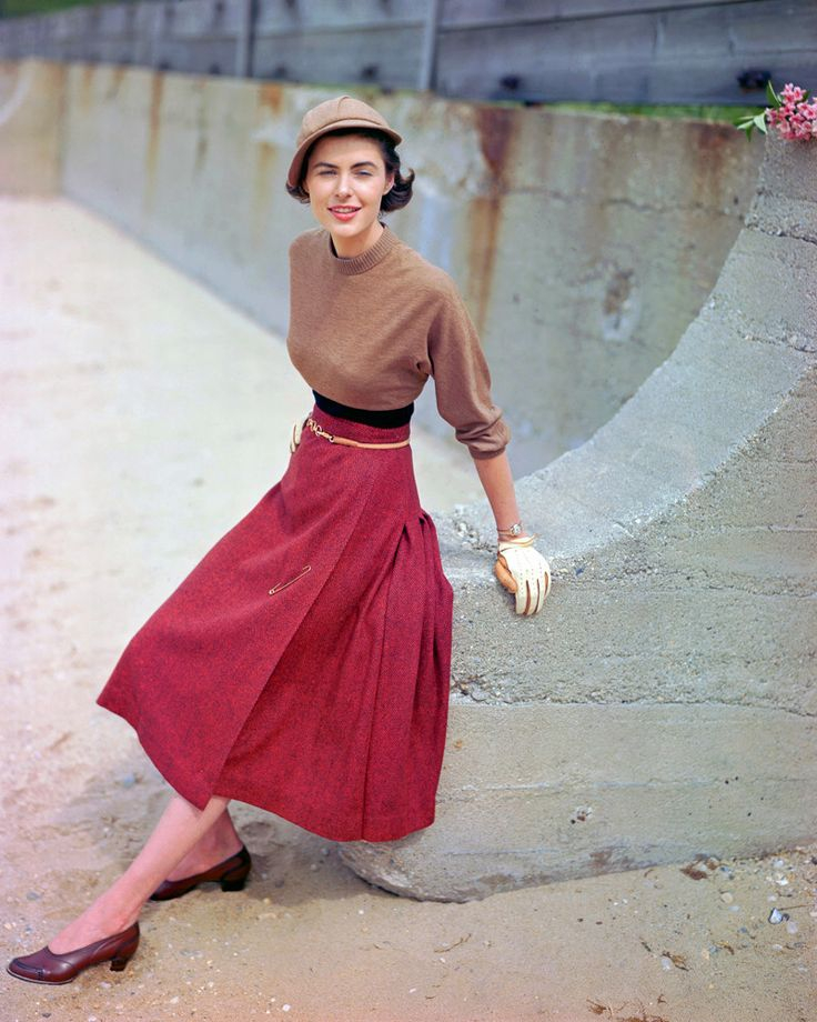 1949 --- A fashion model poses in a tweed skirt designed by M. Sloat, a sweater…