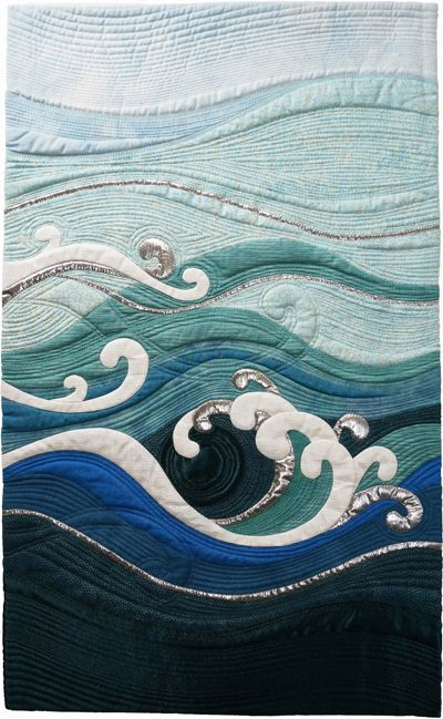 Making Waves by Pat Hilderbrand, SAQA - add appliquéd waves to the sea line.