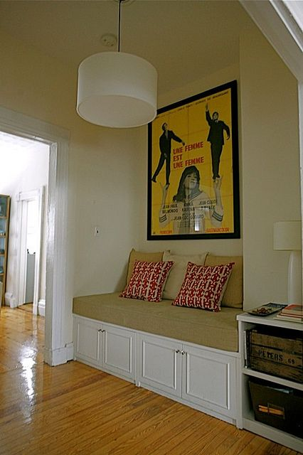 Maximize space under stair case with built in reading nook Built in reading nook