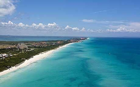 Varadero has an endless and exquisite white-sand beach spotted with palms, and turquoise seas Photo: Photolibrary