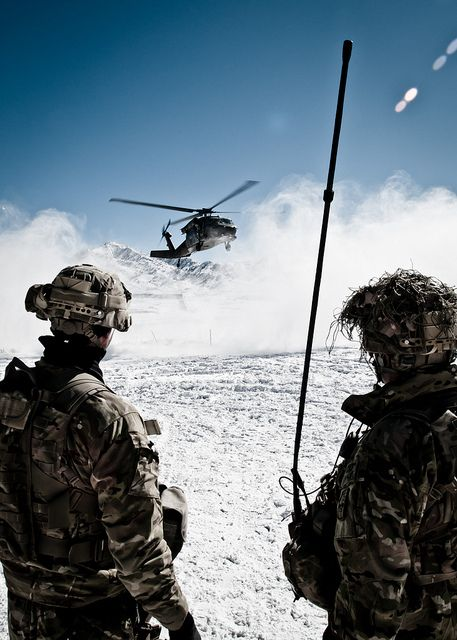 U.S. Army staff sergeants Neil Nunez and Justin Puchalsky, from Company A, 2nd Battalion 28th Infantry Regiment, Task force 3-66, watch the arrival of a helicopter in Afghanistan U.S. Army Photo By Staff Sgt. Charles Crail, Task Force Blackhawk Public Affairs