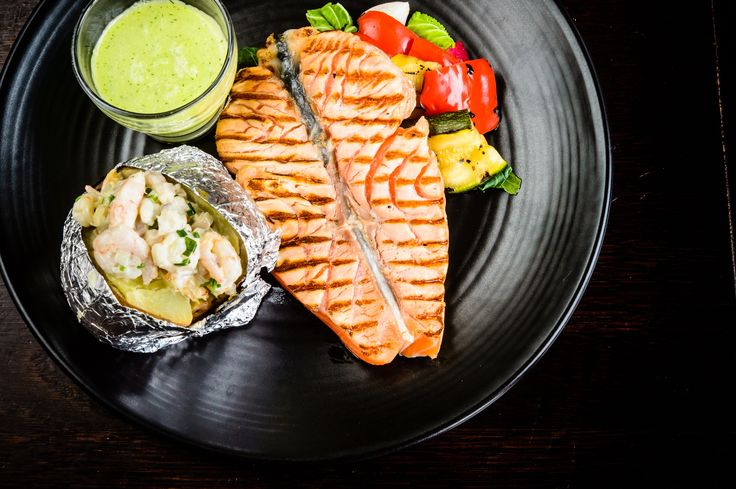 Salmon from Hietalahti pier with baked potato filled with skagen, and cucumber-dill pesto.