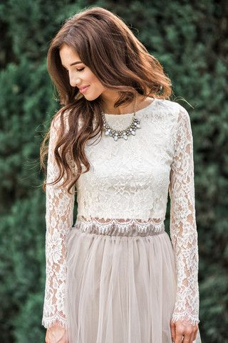 If you've ever struggled finding a top to wear with all of those skirts in your closet, this is your answer! Our delicate Ashlyn lace top in cream complements almost every color and print midi or maxi
