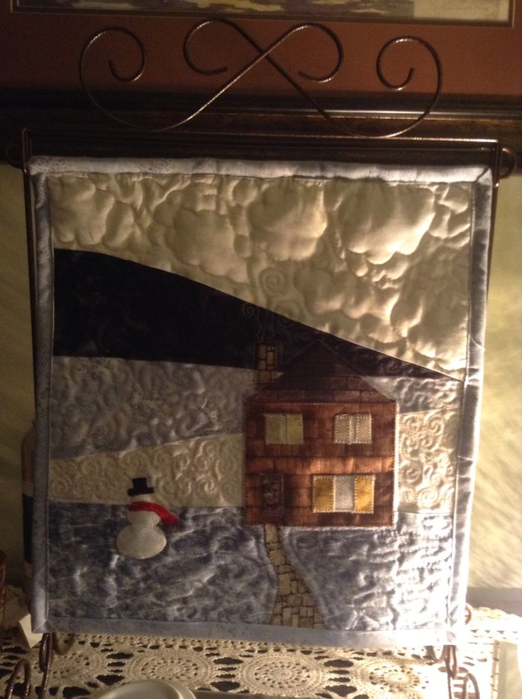 January mini quilt.....love the quilting effects near the light