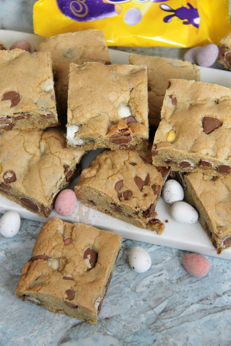 A Yummy Mini Egg & Chocolate Chip Cookie Traybake perfect for Easter.. Mini Egg Cookie Bars are my new Favourite! SO, today is the second day of March. This year Easter is quite late in comparison to last year, but that isn't stopping me… HELLO EASTER RECIPES! Honestly, I won't only be doing Easter related recipes up until the big day, but I felt like posting this one now as its so good. I made this one the other day on a whim because I had bought what felt like a bucket load of Mini Eggs...