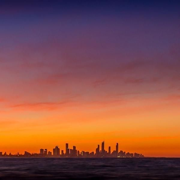 Surfer Paradise skyline at sunset from Burleigh Heads