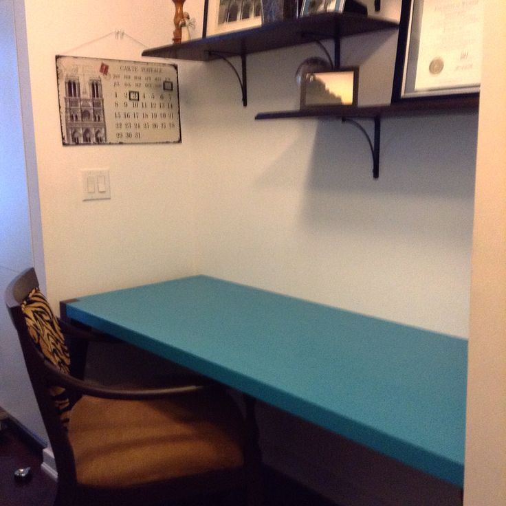 Office space on a budget! Reclaimed table leaves for shelves, recycled dining table cut to fit and painted island blue and a run down chair painted and reupholstered.