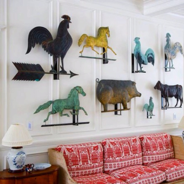 A colorful collection of weathervanes really brings an eclectic, country living room to life.