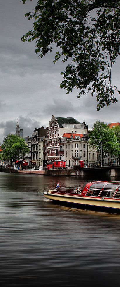 The best way to see Amsterdam is from a canal boat. More of Amsterdam? Visit the Amsterdam board⬇️ #Amsterdam #Netherlands / #canalboat