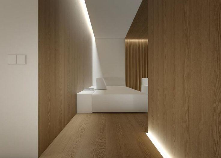 salon de style minimaliste avec des panneaux muraux en bois et un éclairage led indirect
