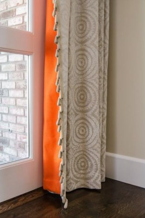 Line curtains with a pop of color.