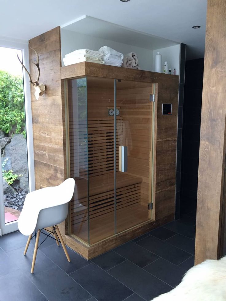 Sauna in the outdoor area with shower: spa of fa. resaneo®, modern wood wood reproduction
