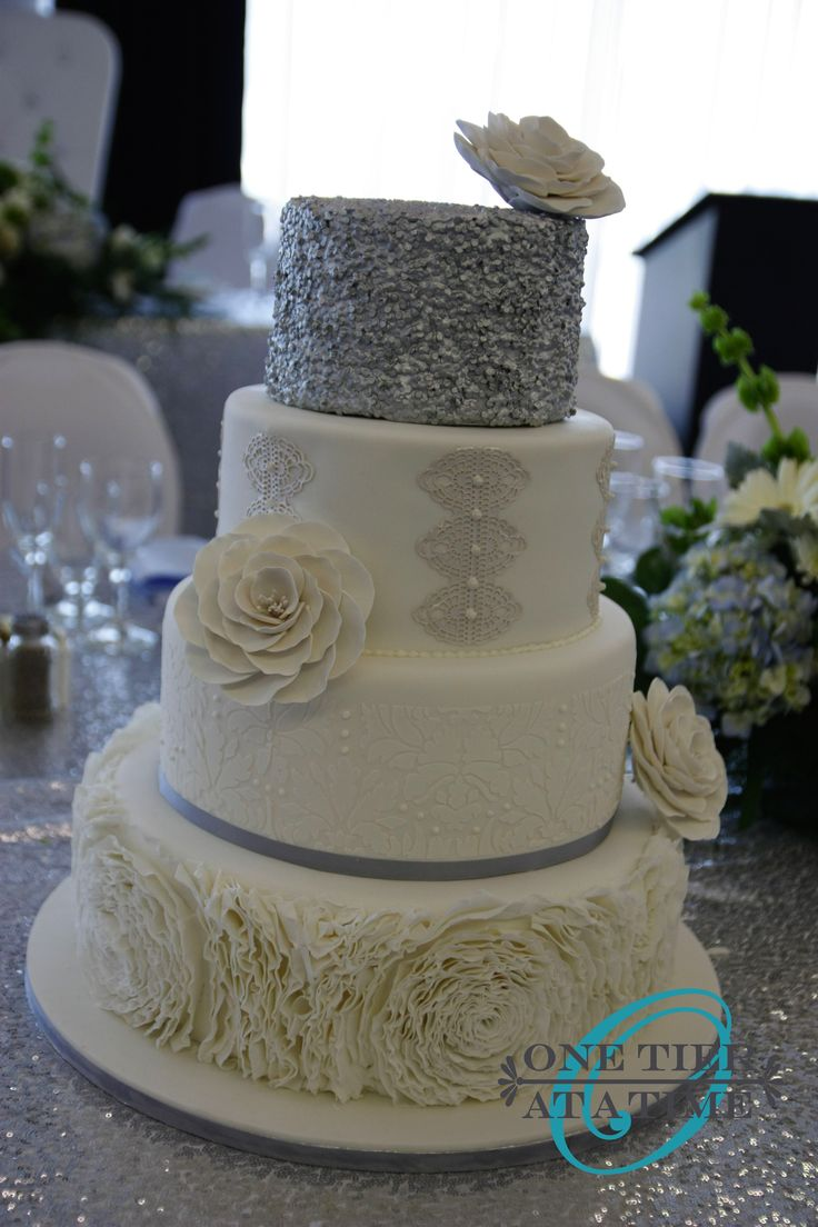 Silver sequin, cake lace, royal icing damask stencil, fondant ruffle rosette cake