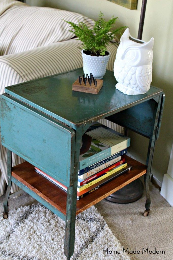 An Antique Metal Typewriter Table Gains Storage With The Addition Of A  Wooden Shelf, And Adds Industrial Charm As A Side Table.