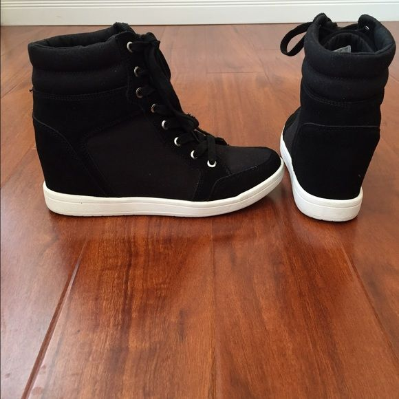DKNY Hi-Top hidden wedge sneakers Brand New Hi-Top black DKNY sneakers with hidden wedge heel, rubber sidewall and sole. Canvas and suede material, NWOT DKNY Shoes Sneakers