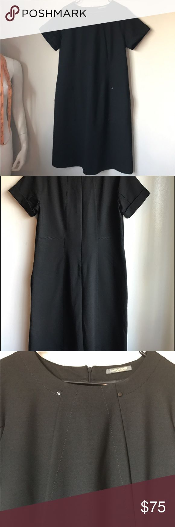Original Marina Rinaldi  black dress WITH POCKETS! This brilliant dress is in perfect condition and has been worn maybe ONE time. The size on the tag says medium and fits very true to size. Feel free to message me for exact measurements.  :) Marina Rinaldi Dresses Midi