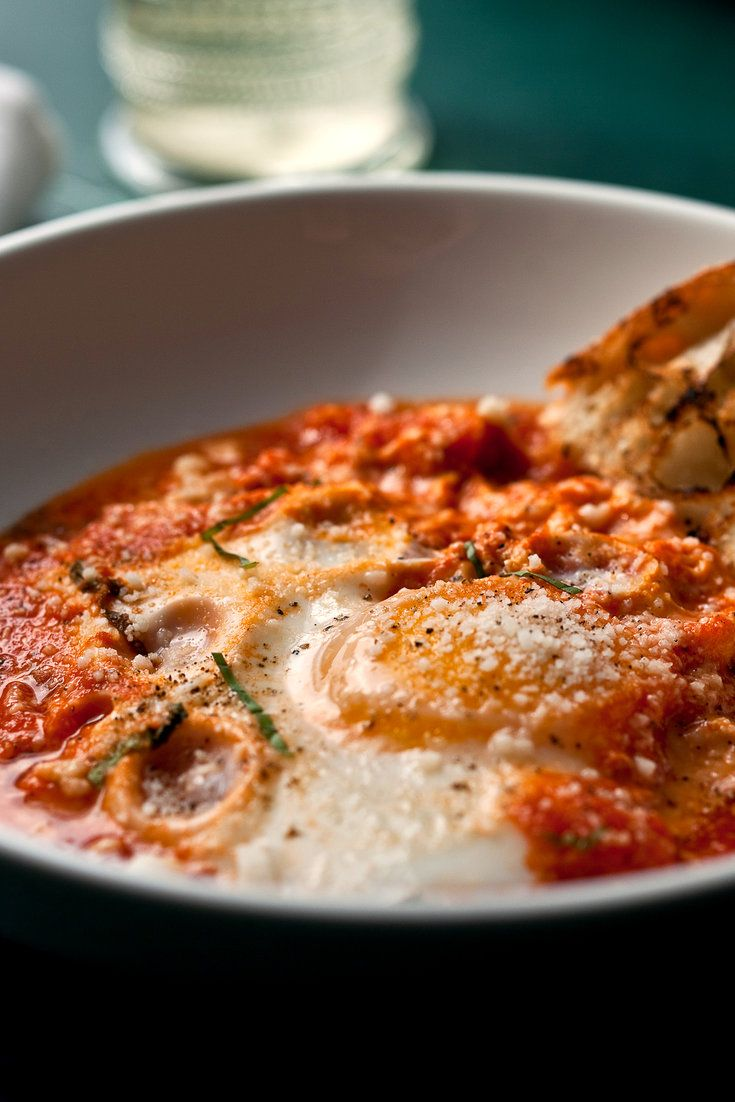 NYT Cooking: In southern Italy this dish has the evocative name Uova al Purgatorio. When I make tomato sauce in the summer, I freeze it in half-cup portions, which makes this meal for one easy to throw together.