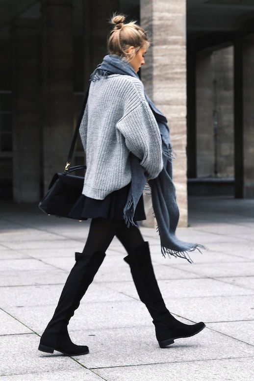 Skinny jeans, over-the-knee boots and an oversized sweater and scarf combo. Such a perfect outfit for staying cosy in Winter!