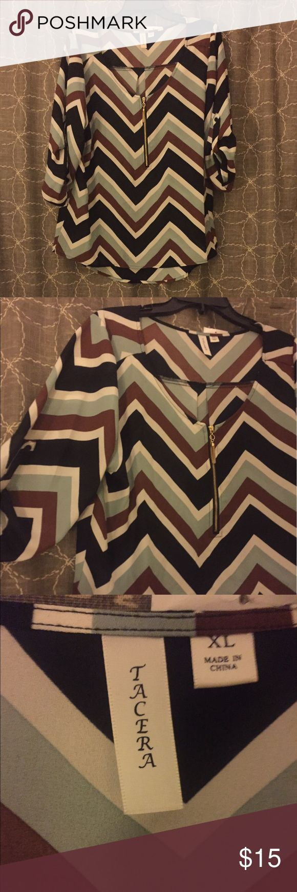 Lightweight Chevron Blouse Chevron stripes- blue, white, brown and black. Cuffed quarter sleeves, sheer but can be worn without camisole. Tops Blouses