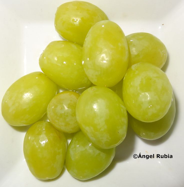 In Spain on New Year's Eve, a popular tradition is to eat twelve grapes for good luck as the bell chimes at midnight at Puerta del Sol, Madrid.