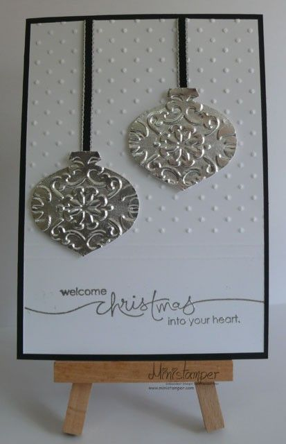 Christmas Card -- emboss, silver glimmer paper, vanilla, and black.                                                                                                                                                                                 More