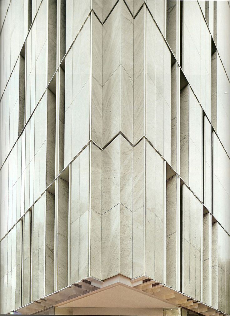 "Exterior stone louvers on ""Stone Block Building"" by Alberto de Souza Oliveira [080] 