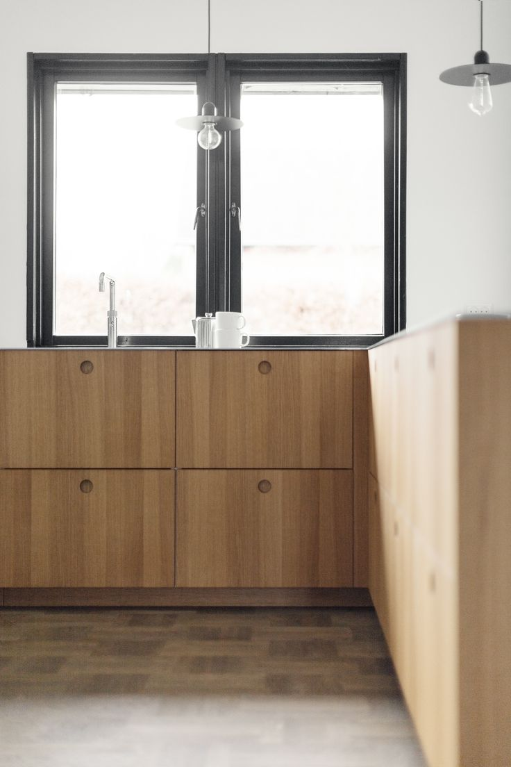 Reform's Basis kitchen in natural oak veneer with a counter top in steel.