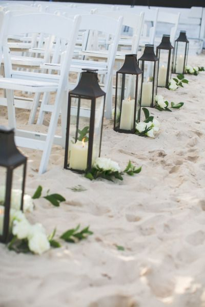 Lanterns and flowers line the beach aisle: http://www.stylemepretty.com/2015/02/04/elegant-riviera-maya-destination-wedding/ | Photography: Samuel Lippke - http://samuellippke.com/