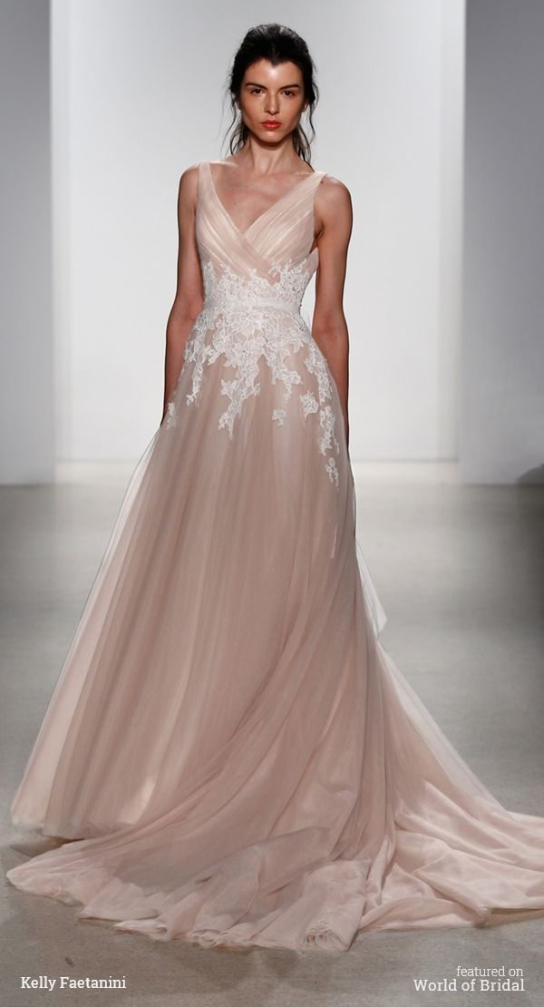 V-neck blush tulle ball gown with embellished ivory Alencon lace applique and tulle self tie sash.
