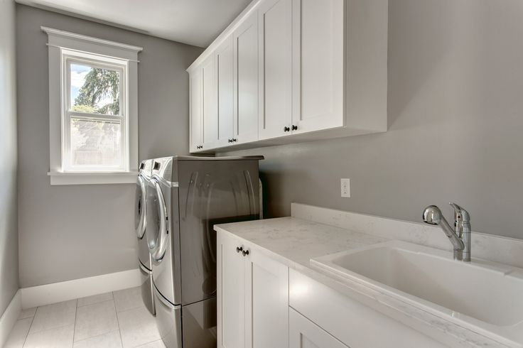 The laundry room is a place where messes are made, so keep yours clean with plenty of storage.  Having upper laundry cabinets to keep things nice and organized, and a sink to help with those tougher stains. By American Classic Homes
