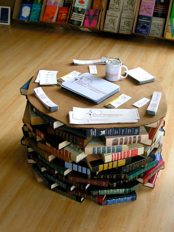 Here's a simple coffee table that can be made with a fewer number of books. By arranging the books in a circular design, it allows you to create a round coffee table that you can place your coffee cup on.