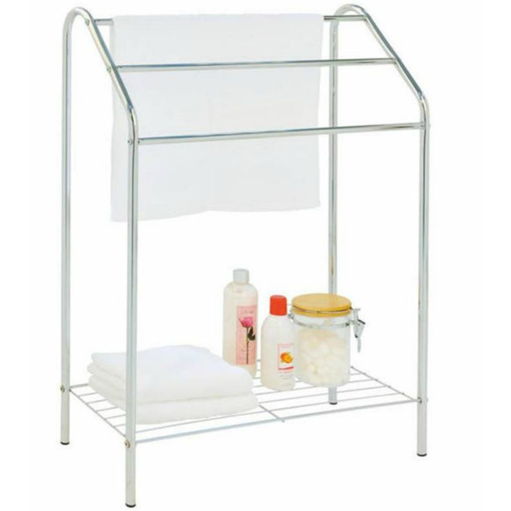 Towel stand with base shelf in chrome. Fits easily into a small bathroom giving you hanging and storage space. Available from Neat Freak online shop.