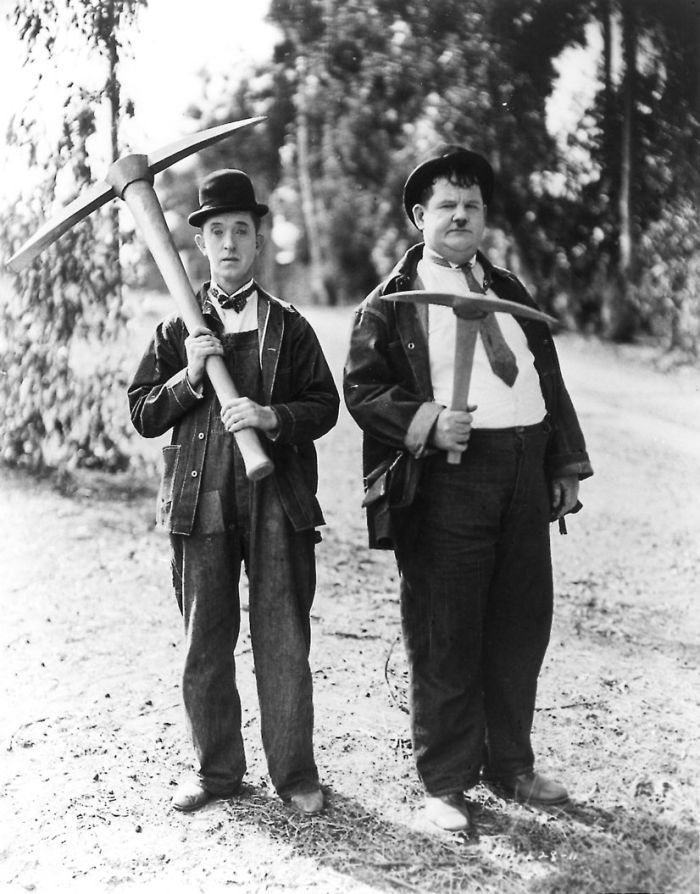 Laurel and Hardy ~ Stan Laurel (1890–1965) and Oliver Hardy (1892–1957). They became well known during the late 1920s through the mid-1940s for their slapstick comedy with Laurel playing the clumsy and childlike friend of the pompous Hardy. They officially became a team in 1927 when they appeared together in the silent Putting Pants on Philip. As a team they appeared in 107 films. In 2005, they were voted the seventh greatest comedy act of all time by a UK poll of fellow comedians.
