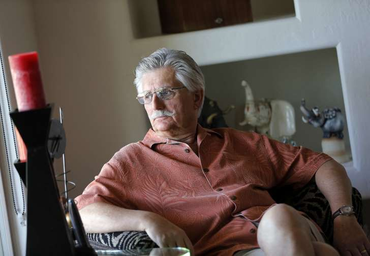 FILE - This May 20, 2014 file photo shows Fred Goldman, father of victim Ron Goldman, in his home in Peoria, Ariz. A lawyer for the family of Fred Goldman says O.J. Simpson is profiting from autographs since his release from prison and should pay the money toward a wrongful death judgment exceeding $70 million. Attorney David Cook plans to ask a Los Angeles Superior Court judge Tuesday, Jan. 30, 2018, to order Simpson to hand over future money he makes autographing sports memorabilia to…