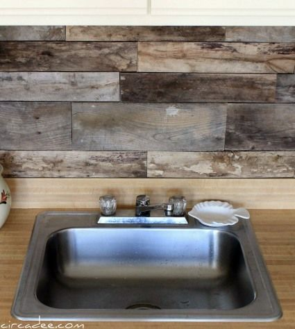 "DIY Backsplash made from reclaimed shipping pallets, cut into 18"" segments, washed in the tub (and treated with something I wonder?)."