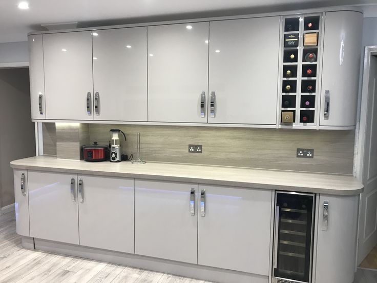This Glendevon Gloss Cashmere Kitchen Has Tall U0026 Curved Units, Along With  Grey Oak Effect