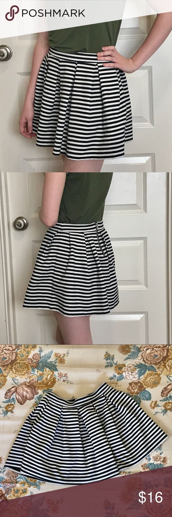 Bethany Mota striped pleated skirt Fun and flirty skater skirt from Aeropostale's Bethany Mota collection! Black and white stripes with pleats all around and an exposed supper closure in back. Falls upper mid thigh depending on where you choose to have it sit on your waist. Aeropostale Skirts Circle & Skater