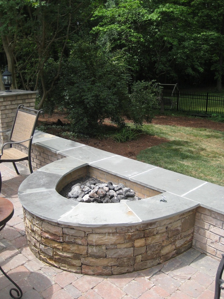 Half Circle Stone Firepit With Attached Seating Wall