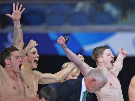 Commonwealth Games 2014: Proud day for Britain as home nations enjoy a night to remember in the pool. Three of England's 4x100m relay medley quartet, Chris-Walker Hebborn, Adam Barrett and Adam Peaty, celebrate their success (Getty)