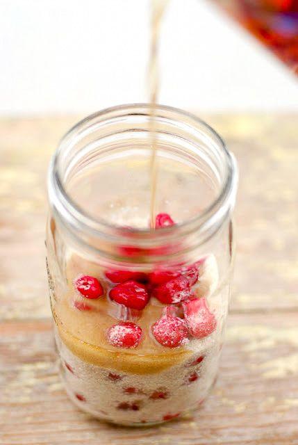 Cherry Bounce (cordial) recipe. Pouring bourbon into cherries and sugar - BoulderLocavore.com