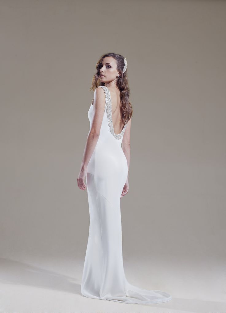 Sabina Motasem - Emilienne.  An intricately beaded round neck & deep back with a classic bias cut column shape for an elegant line.