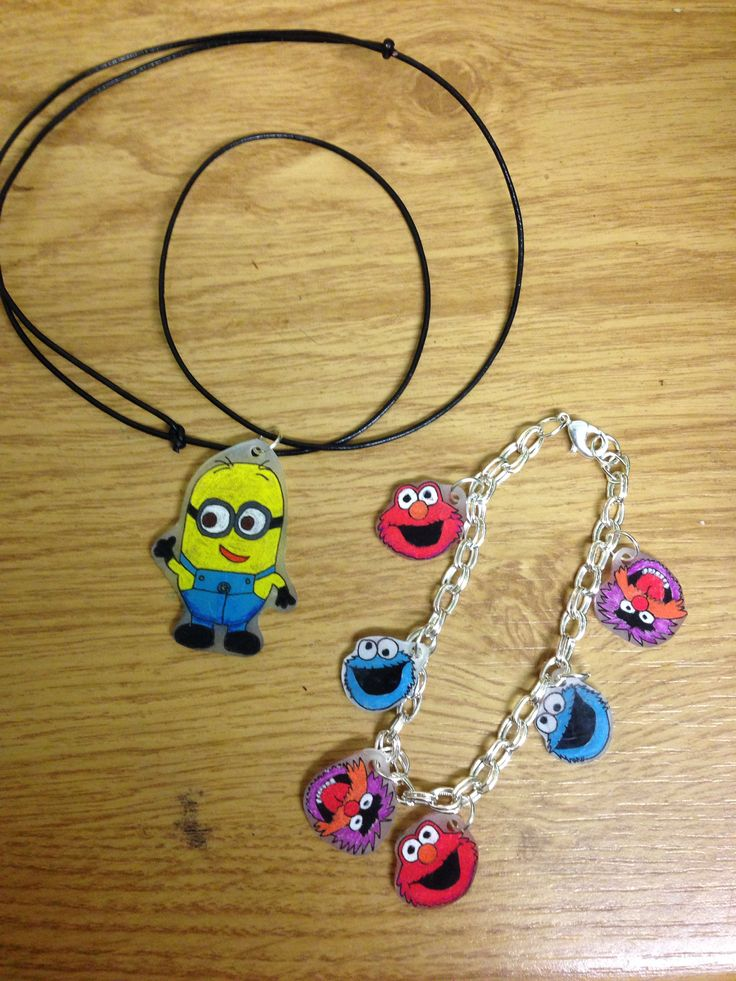 Homemade minion necklace and Elmo, Cookie Monster and Animal charm bracelet. All with hand drawn shrink plastic charms. For my niece for cmas