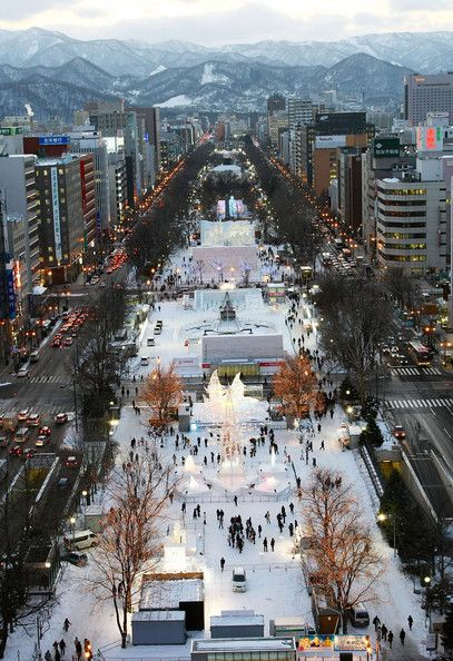 Visitors walk around exhibits at the 60th Sapporo Snow Festival ahead of its opening at Odori Park on February 4, 2009 in Sapporo, Japan. Th...