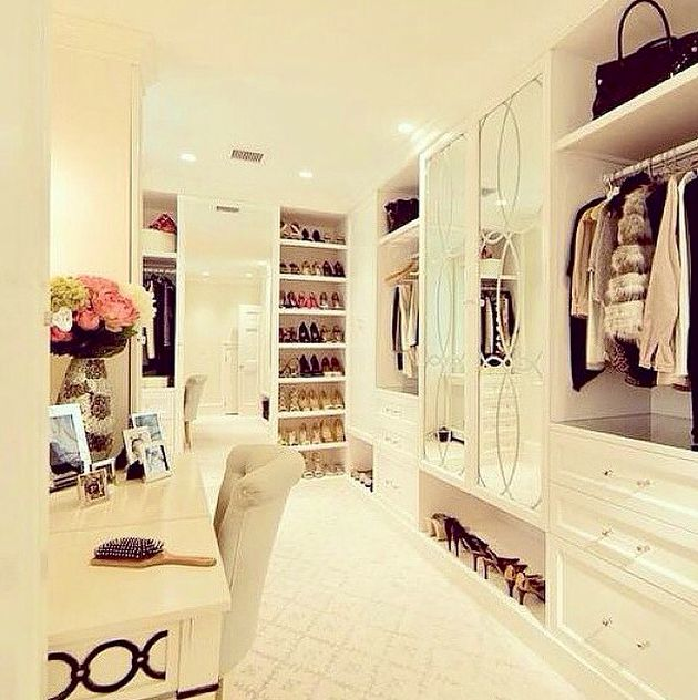 Custom walk-in closet with an enamel white finish and mirrored compartment doors.
